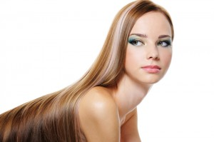 Portrait of beautiful pretty young girl with long smooth luxuriant hair