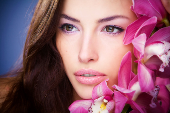 brunette woman beauty portrait with orchid